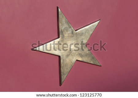 Goden 3d pentagram star at purple background