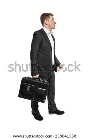 Going business man holding brief case over white