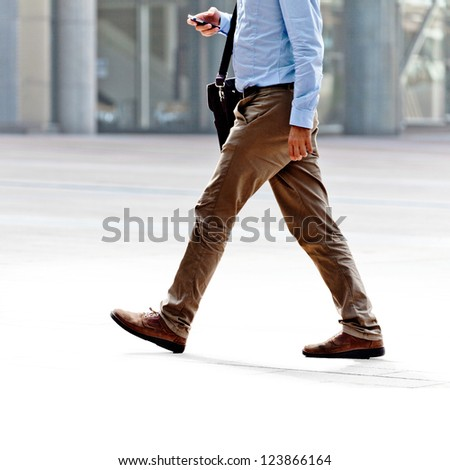Going employee calling on the phone on the background of the office. - stock photo