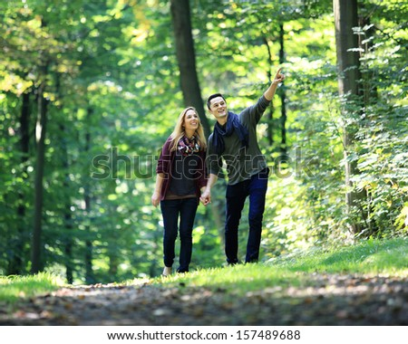 going for a walk through the forest on a romantic date - stock photo