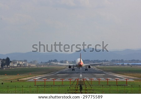 Going to the airport runway on landing aircraft - stock photo