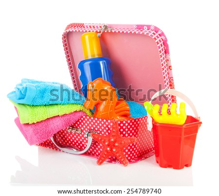 Going to the beach; accessories and suitcase over white background - stock photo