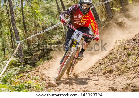 GOIS, PORTUGAL - JUNE 23: Claudio Loureiro during the 4th Stage of the Taca de Portugal Downhill Vodafone on june 23, 2013 in Gois, Portugal. - stock photo