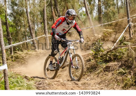 GOIS, PORTUGAL - JUNE 23: Diogo Abreu during the 4th Stage of the Taca de Portugal Downhill Vodafone on june 23, 2013 in Gois, Portugal. - stock photo