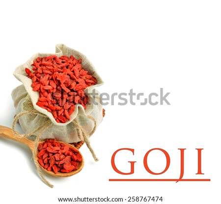 Goji berries in the sack bag with wooden spoon isolated on white - stock photo