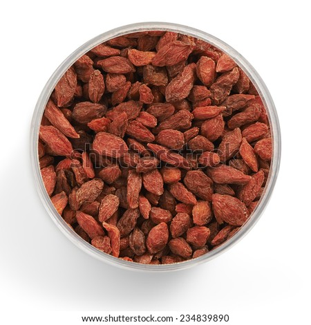 goji berries shot from above in a glass jar with a soft shadow