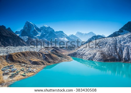 Gokyo lake with snow capped mountains of the Himalayas. Early morning. View from Gokyo Ri - stock photo