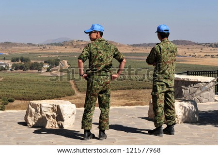 GOLAN HEIGHTS-AUG 23:UNDOF soldiers examine the Israeli-Syrian border on August 23 2009 in the Golan Heights, Israel.It established in 1974 by Security Council resolution 350 following Yom Kippur war