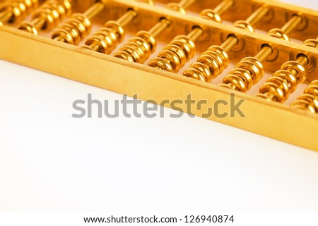 gold abacus closeup,chinese traditional business concept background - stock photo