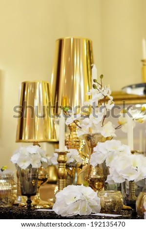 Gold and black wedding table set - stock photo