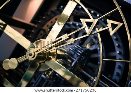 Gold and blue clock detail, side view, hand close - stock photo