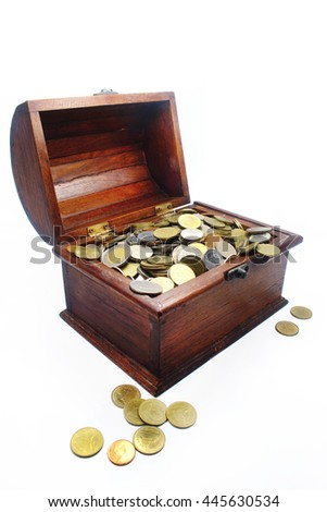 gold and money in the treasure Chest isolated