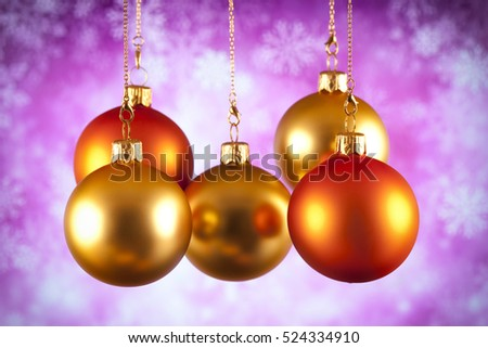 Gold and red Christmas baubles on abstract background