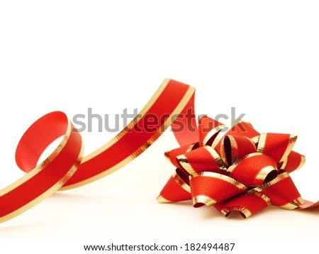 Gold and red gift bow with ribbon on white