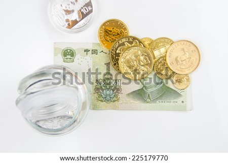 Gold and silver backed currency - stock photo