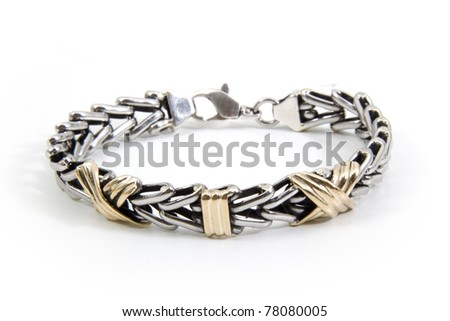Gold and silver bracelet over white background - stock photo