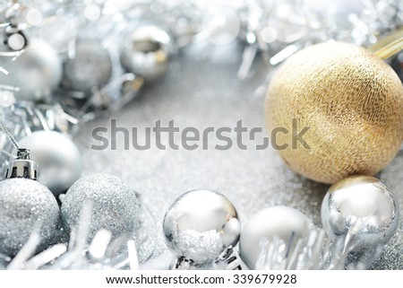 gold and silver christmas ball on glitter background