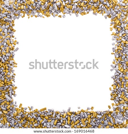 gold and silver grains of small size, scattered in a frame isolated on white background - stock photo