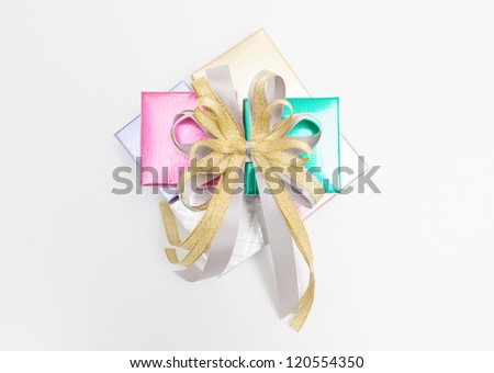 Gold and silver ribbon on many boxes. - stock photo
