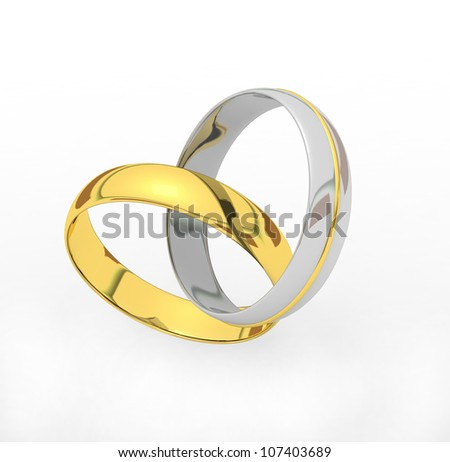 Gold And Silver Wedding Rings Connected Like A Heart