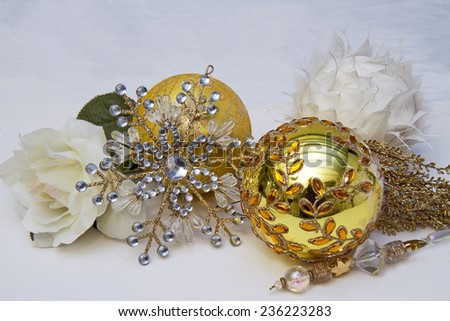 Gold and White Christmas decorations isolated on white.