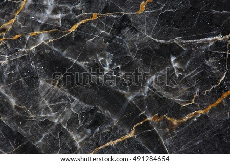Gold and white Patterned natural of dark gray marble (Gold Russia) texture background for product design.