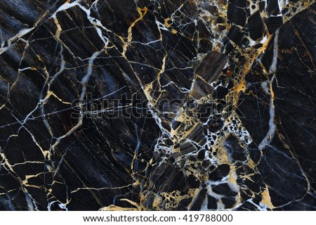 Gold and white patterned structure of dark gray marble texture for design.
