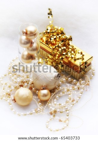 Gold and white present, ornaments and garland