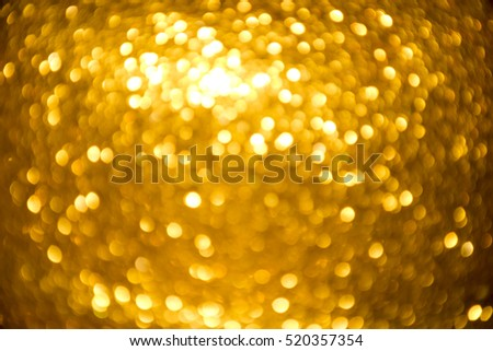 Gold and yellow Christmas Glittering background. Holiday abstract texture Festive