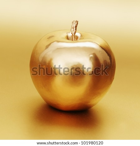 gold apple on gold background