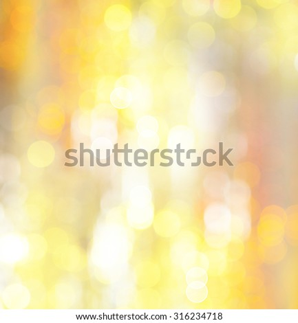 Gold background. Abstract holiday glowing golden background. Christmas Holiday glowing Abstract Glitter Defocused blinking lights. Blurred Bokeh. Photo  - stock photo