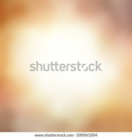 gold background blur, warm orange and gold hues with shiny white center with copyspace for text - stock photo