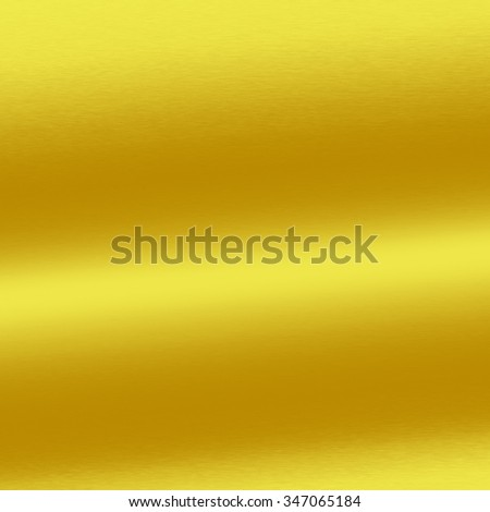 gold background metal texture with oblique line of light - stock photo