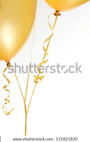 Gold balloons and ribbon on white background - stock photo