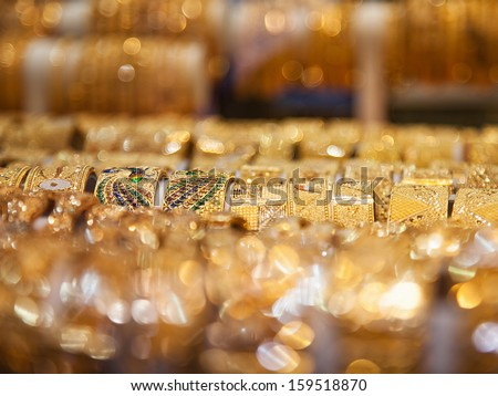 Gold bangles in a Dubai gold souk. United Arab Emirates - stock photo