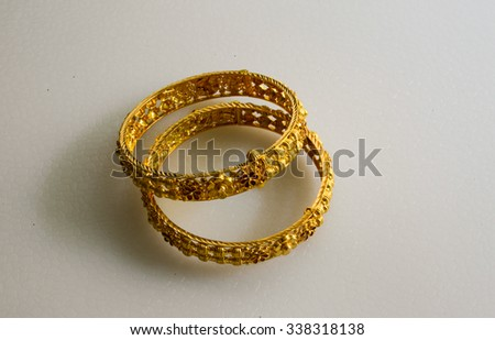Gold bangles with intricate design and crafting.  - stock photo