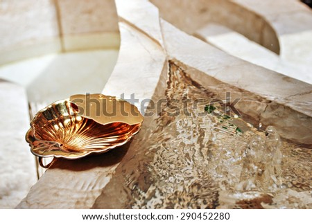 Gold Baptistery Ladle or Vessel  - stock photo