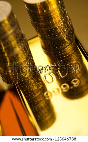 Gold bar and coins - stock photo