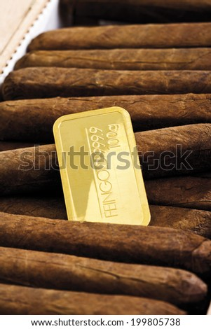 Gold bar in cigar box - stock photo