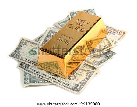 gold bar with bank notes - stock photo