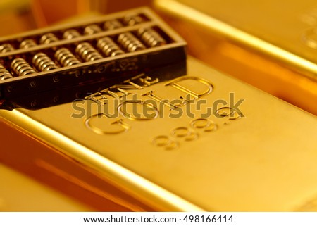 Gold bars and gold abacus