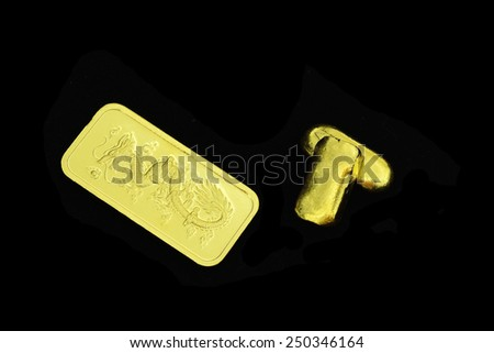 gold bars dragon sculpture isolated on black background for chinese new year - stock photo