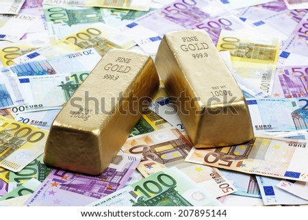 Gold bars on heap of euro notes