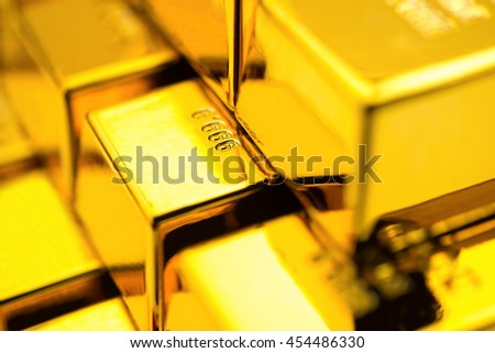 gold bars stacked up close up - stock photo