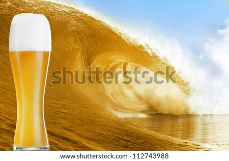 Gold beer glass over a big beer wave. - stock photo