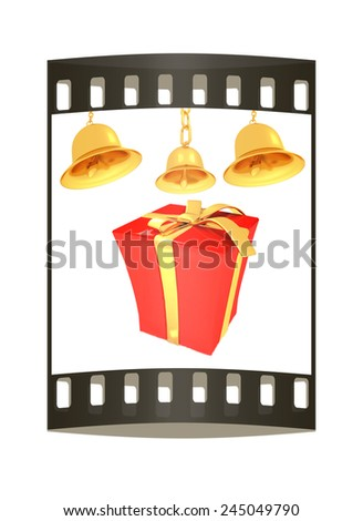 Gold bell and red gift box with golden ribbon on white background. The film strip - stock photo