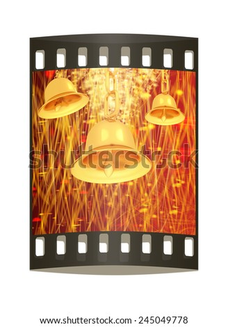 Gold bell on winter or Christmas style background with a wave of stars. The film strip - stock photo