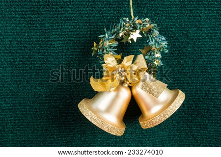 gold bells on green carpet , use for background - stock photo