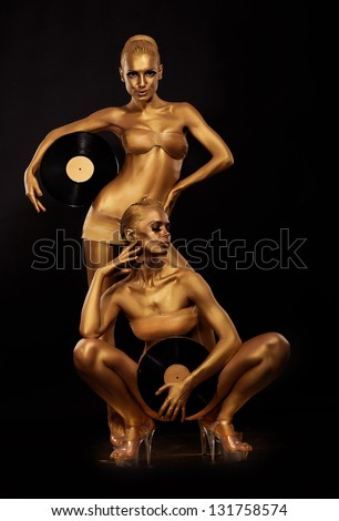 Gold Bodyart. Coloring. Golden Women Silhouettes with Retro Vinyl Records over black. Creative Art Concept