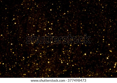 gold bokeh lights defocused. abstract background